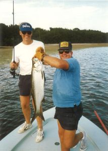 Nat Ragland holding a baby tarpon caught off Big Pine in 1989